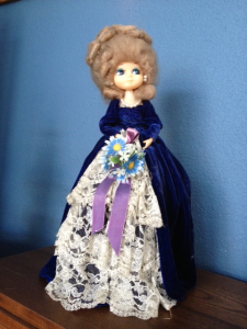 This is the doll my mother made from an old dress of mine and her own wedding dress.